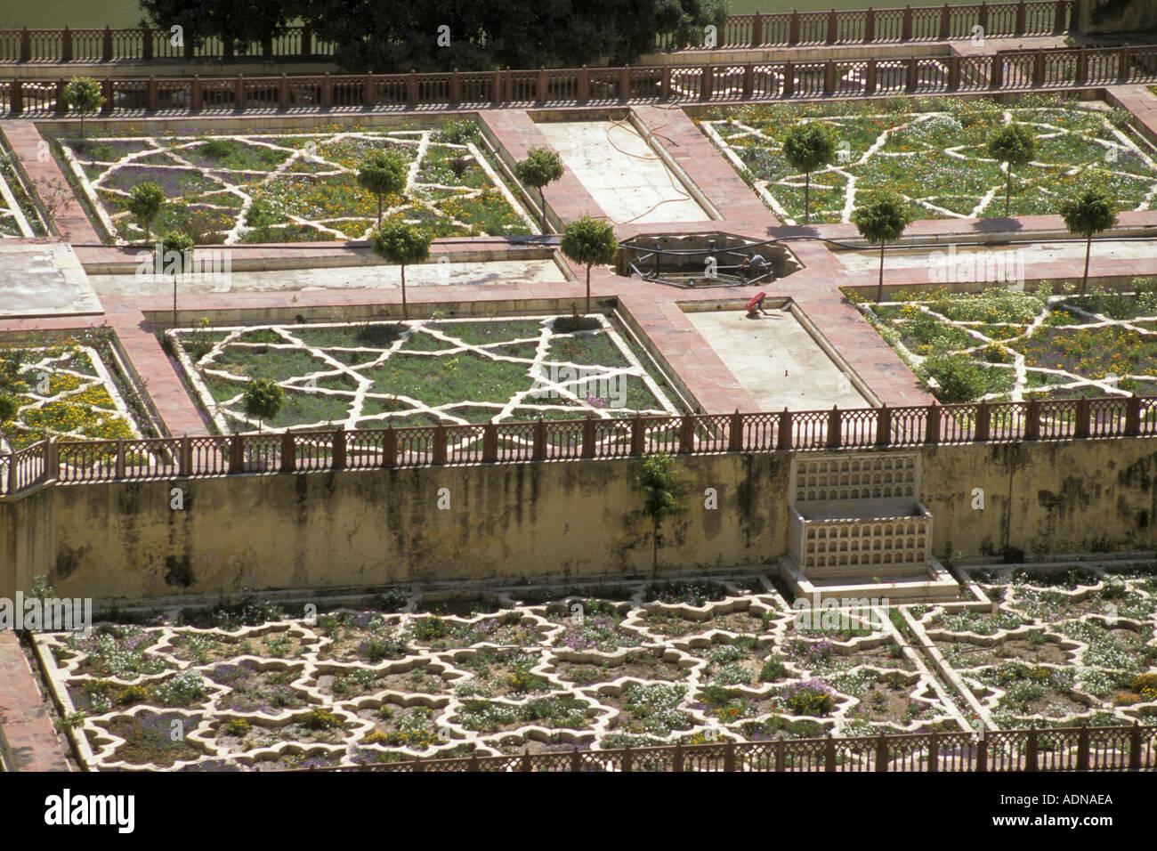 India Rajasthan Jaipur Amber Fort woman sweeping gardens Stock Photo ...
