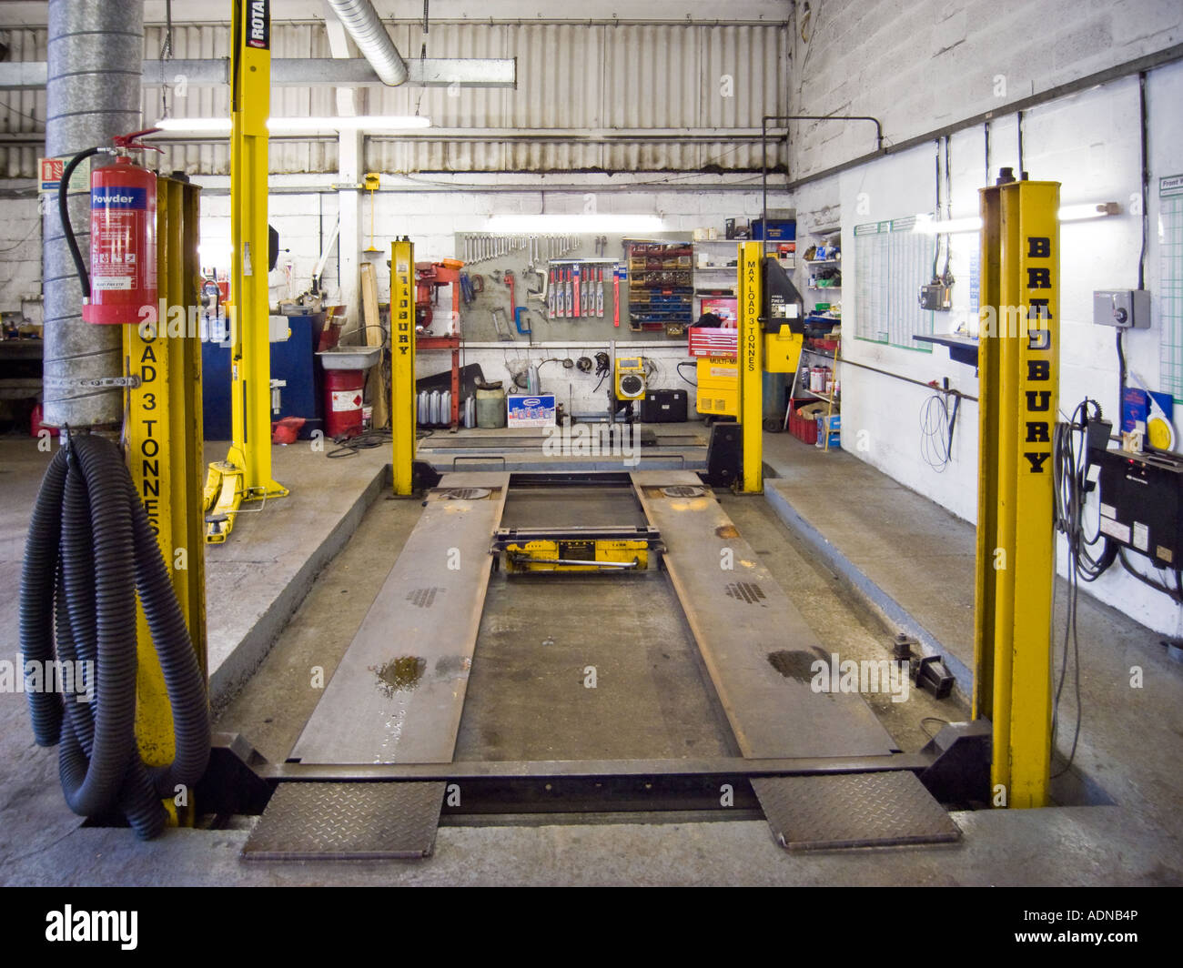 Car repair garage with hydraulic car lift stock photo for Garage reparation auto