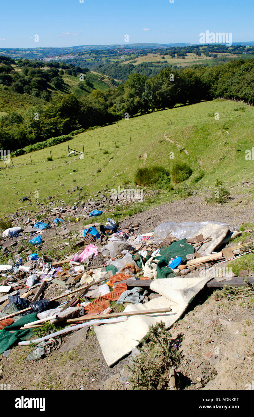 Builders rubble and general household waste dumped in countryside Cefn Crib Wales UK - Stock Image