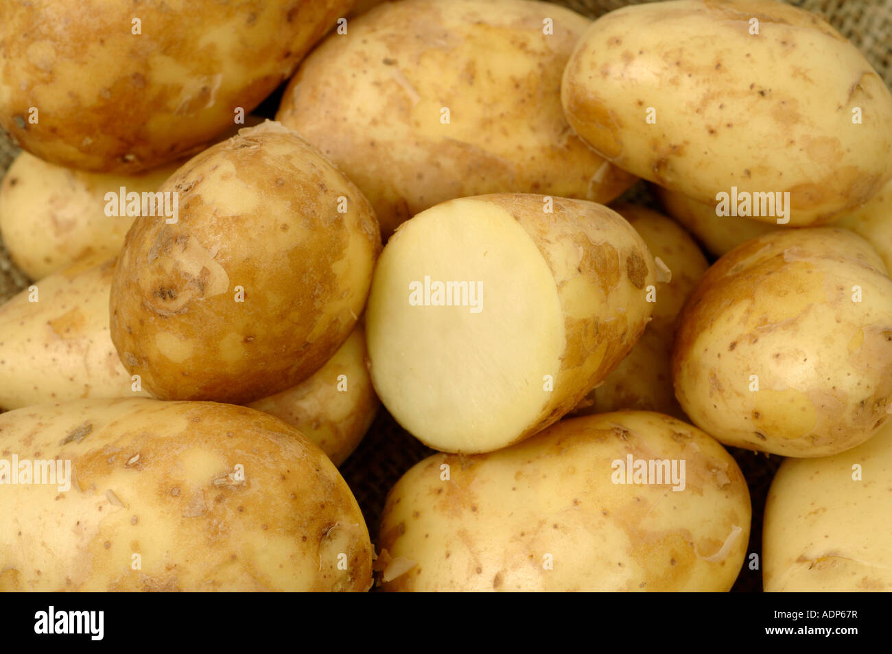 Jersey Royal potatoes ex supermarket shop bought tubers - Stock Image