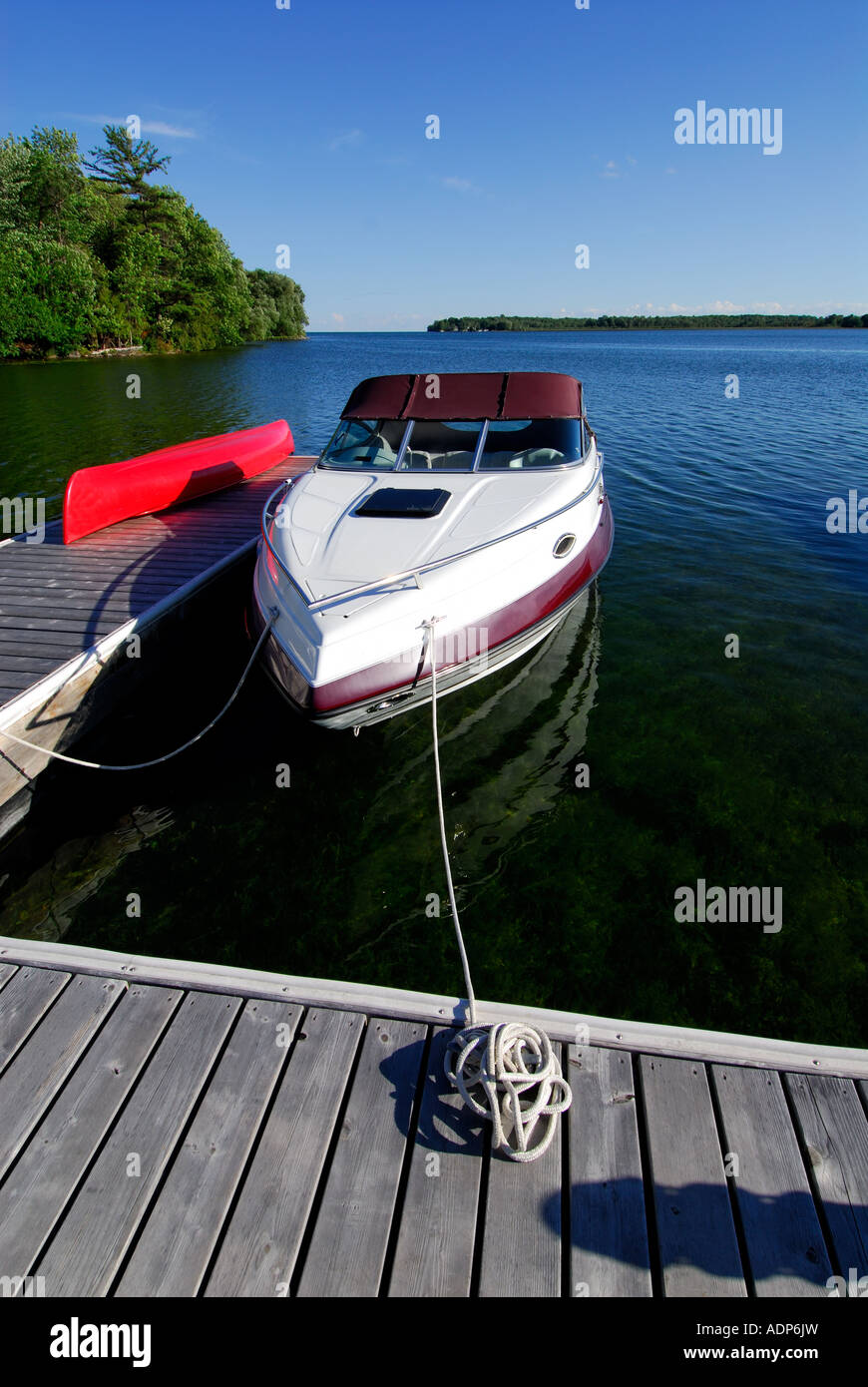 Cabin Cruiser Boat Moored At A Dock On Lake Simcoe Orillia