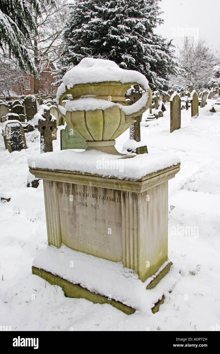 Snow covered monument of Hugh Gaitskell s grave Hampstead Parish churchyard London UK - Stock Image