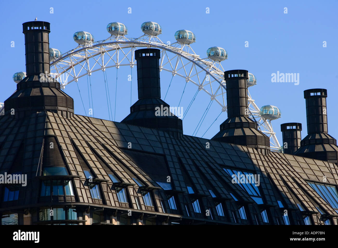 British Airways London Eye seen above rooftops England United Kingdom - Stock Image