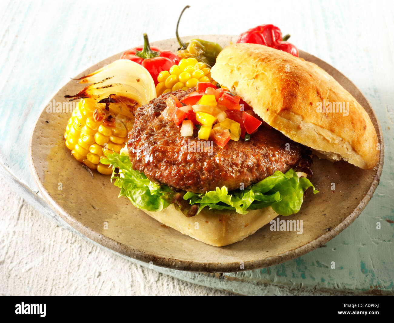 beef burger in a chabatta roll - Stock Image