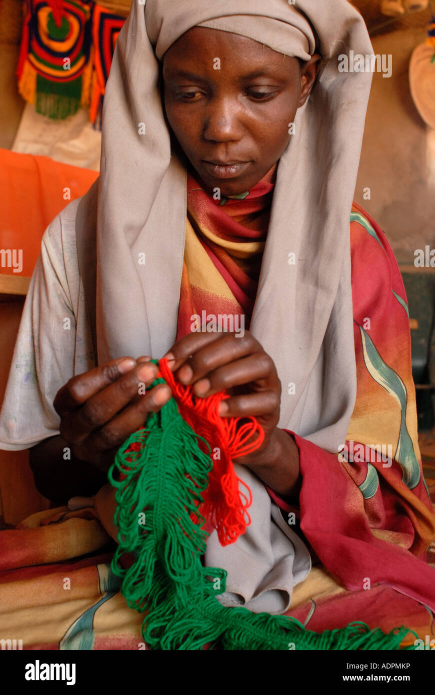 Africa.Toulum camp for Sudanese refugees .Eastern Chad .Nedifs Adam Mahamat, community assistant, crocheting - Stock Image