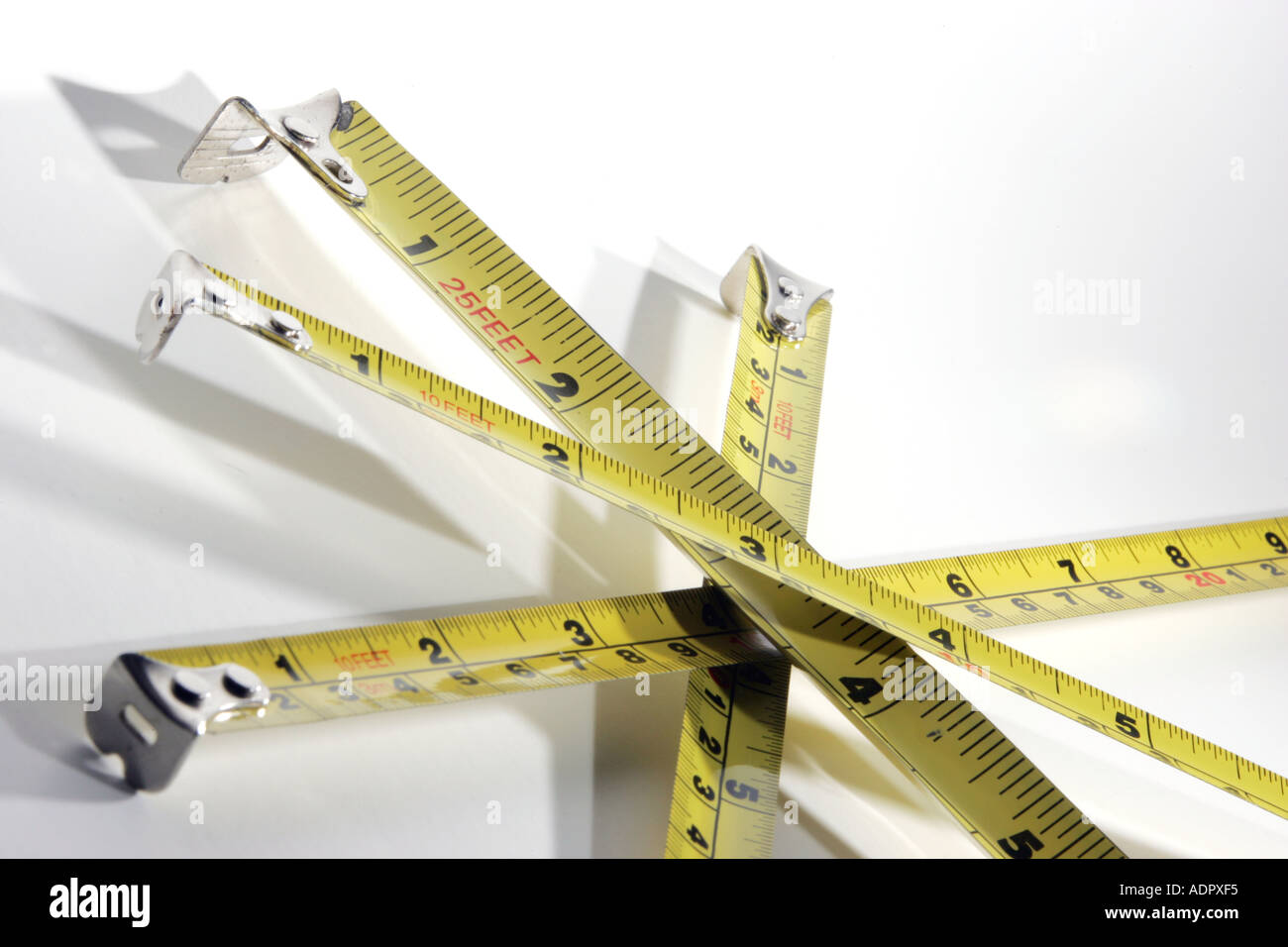 Yellow Steel Tape Measures Criss Crossed Feet Inches Centimetres Metres