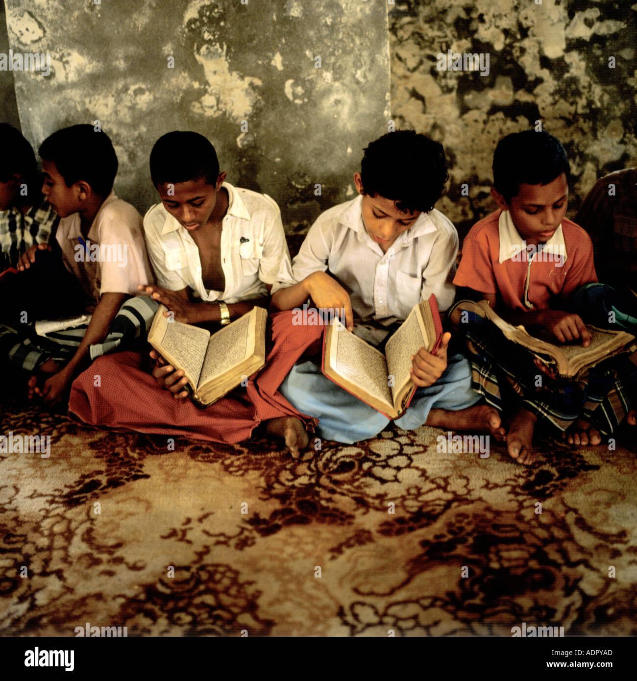 Boys learning from the Koran Zabid Tihama Yemen Arab Republic - Stock Image