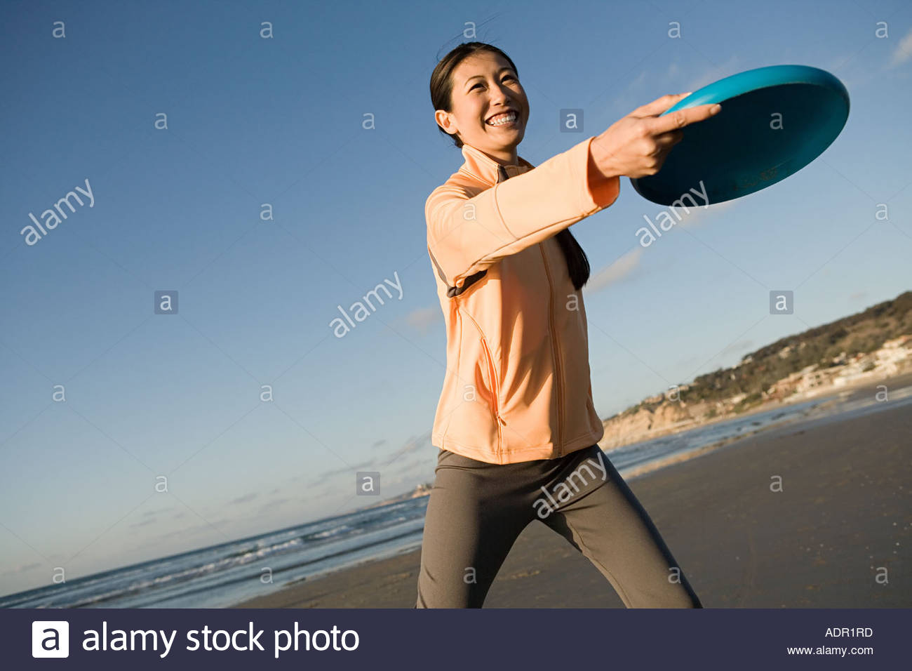Woman throwing a lying disc - Stock Image