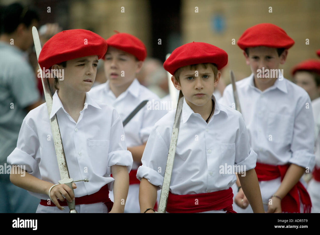 b20fa6efeec3d Boys wearing Basque beret the txapela and holding swords during Basque folk  dance Plaza Arriaga Bilbao