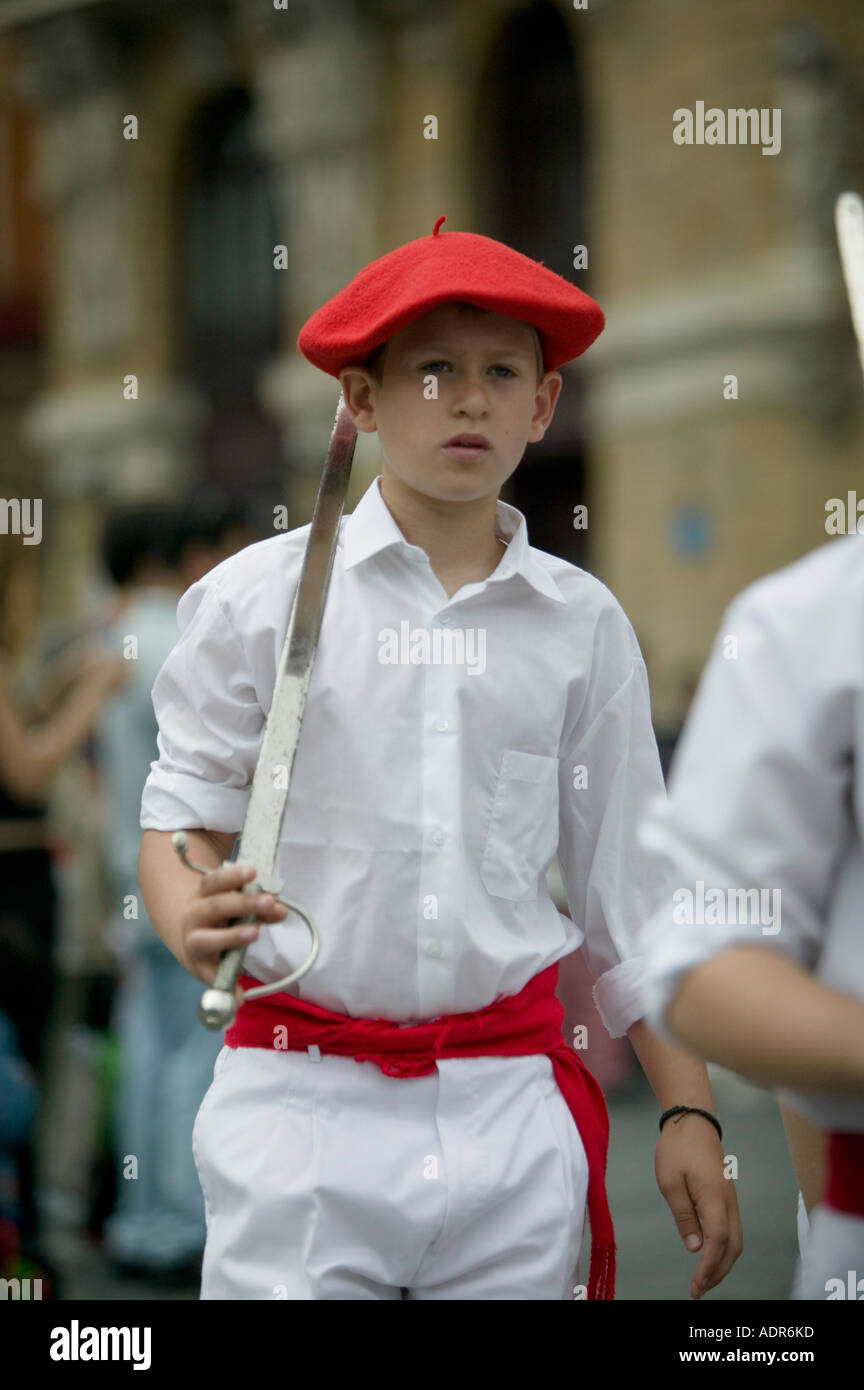 12ef32fccc6e3 Boy wearing Basque beret the txapela and holding sword during Basque folk  dance Plaza Arriaga Bilbao Basque Country Spain