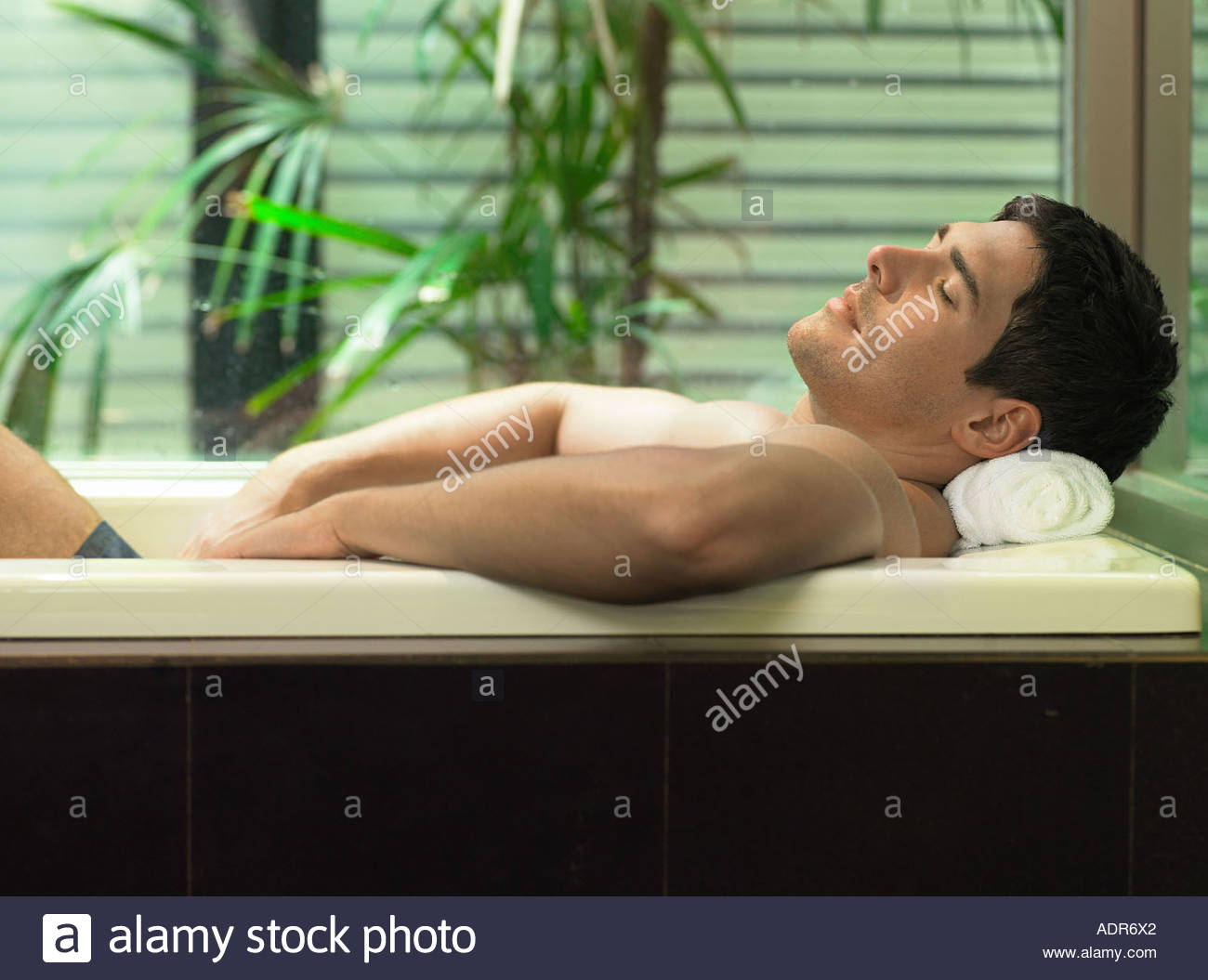Man relaxing in the bath - Stock Image