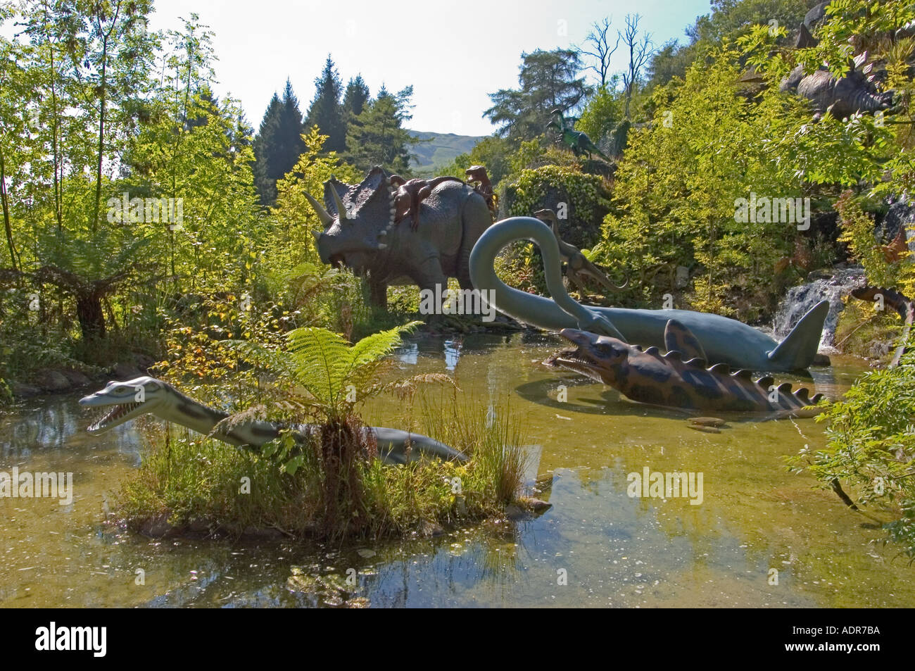 Dinosaur models at the Dan yr Ogof Showcaves and Dinosaur Park, Brecon Beacons, Mid Wales, UK - Stock Image