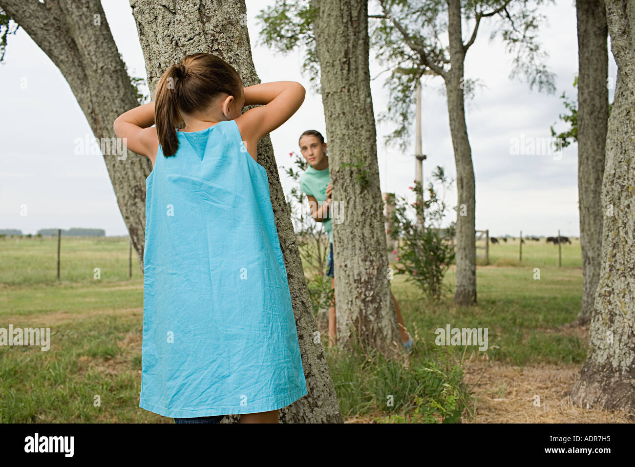 Girls playing hide and seek Stock Photo