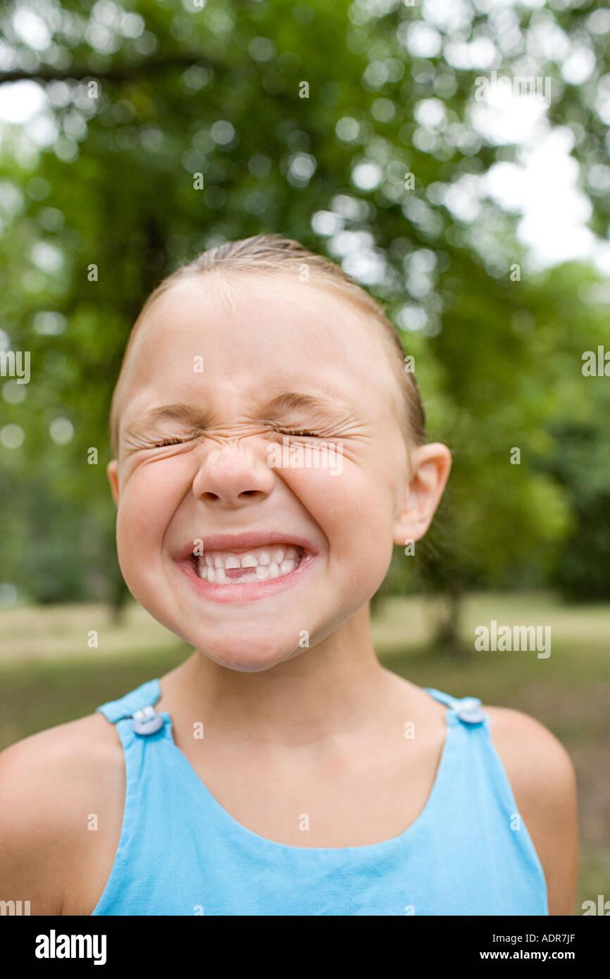 Grimacing girl - Stock Image