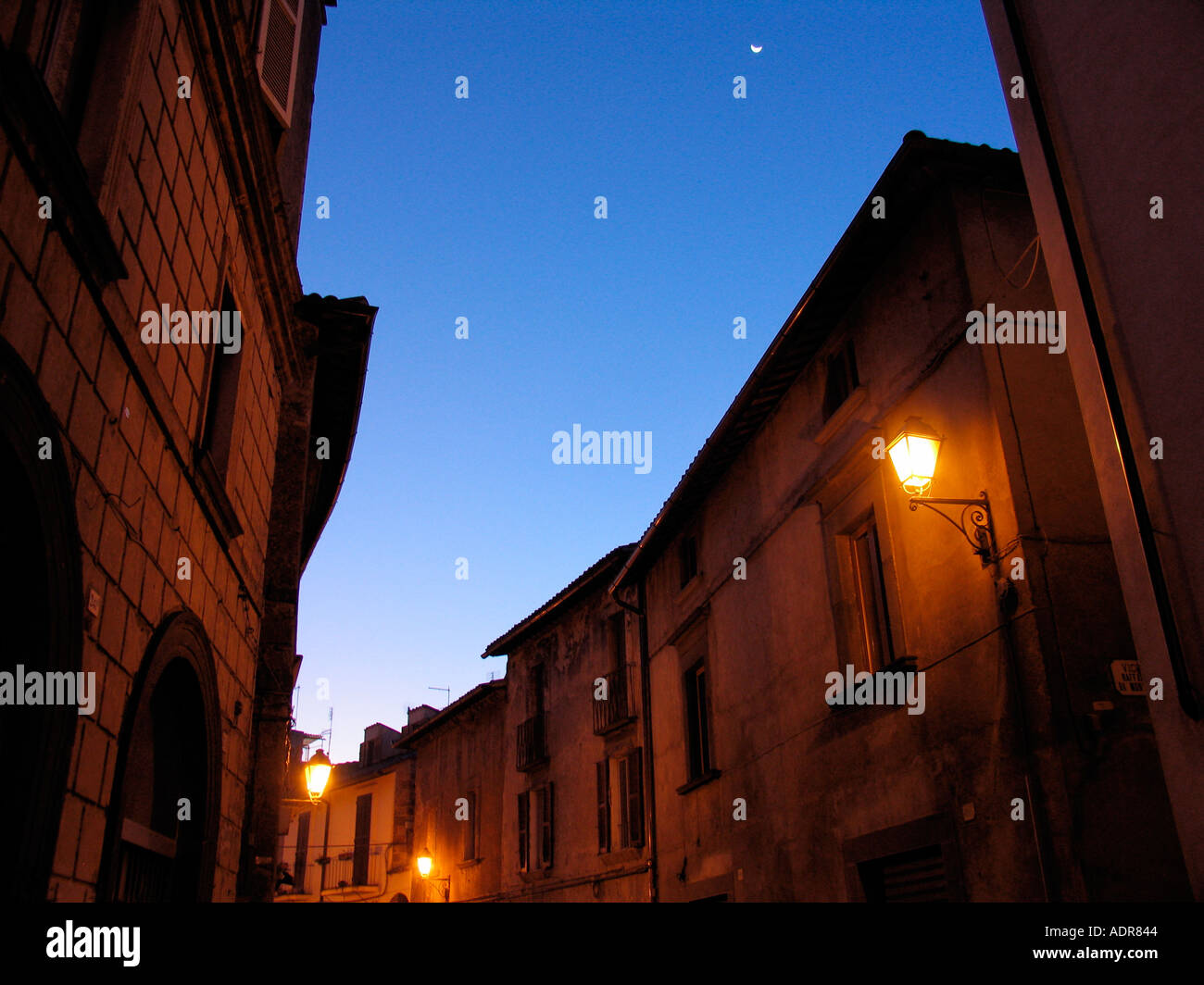 Crescent moon in sky above sleepy houses on Corso Cavour in