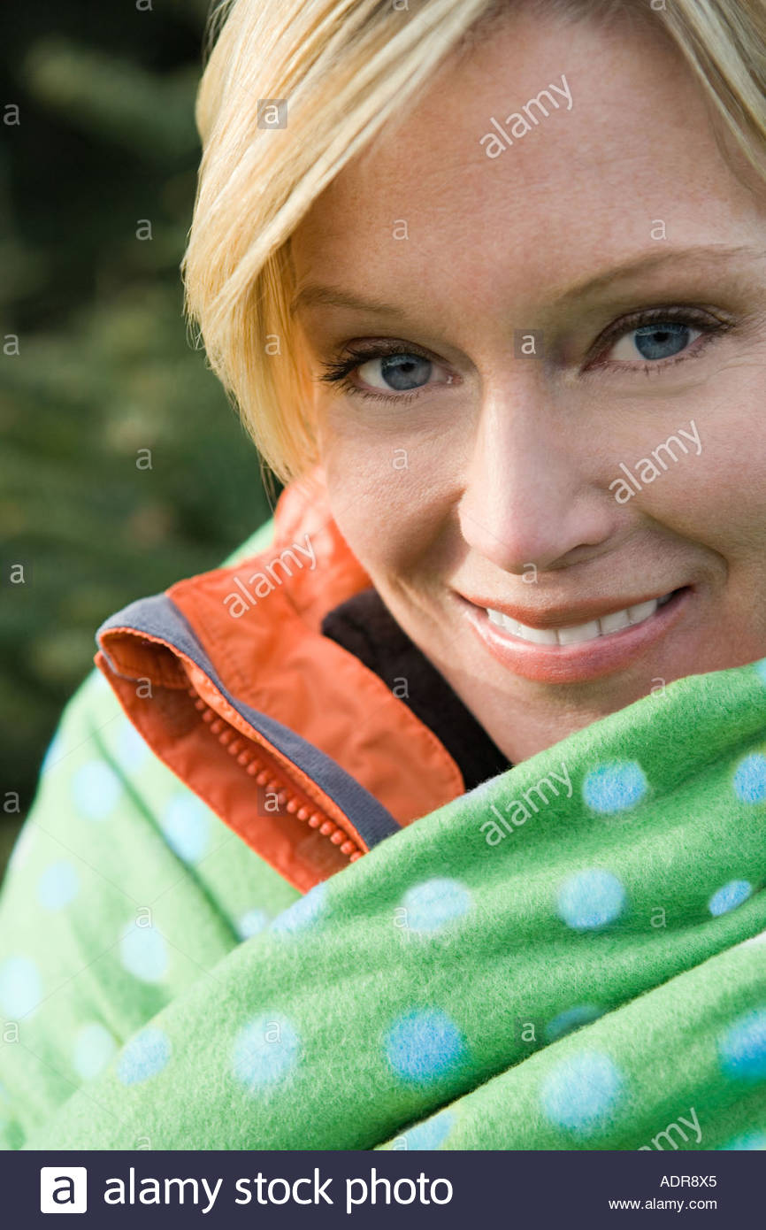 Woman wrapped in a blanket - Stock Image