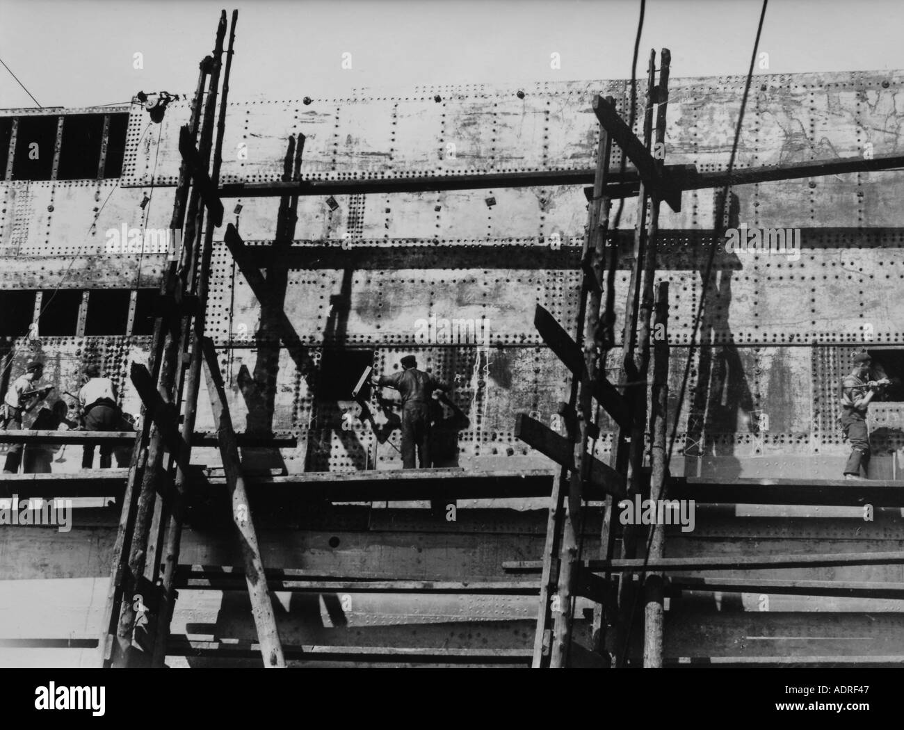 UK Scotland Greenock Shipyard of the 1890 s building the SS Isis fitting the hull plates - Stock Image