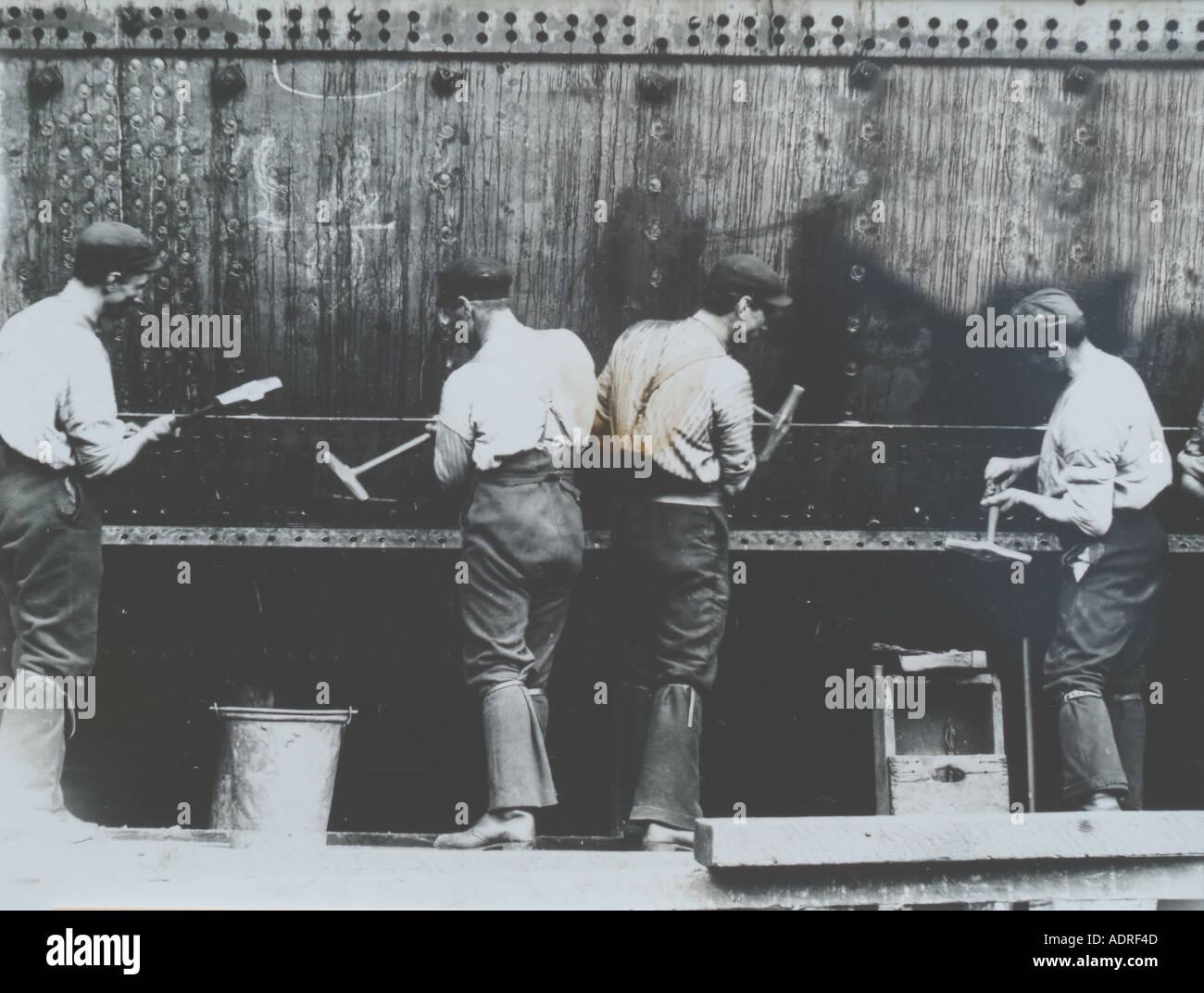 UK Scotland Greenock 1890 s shipyard building the SS Isis Riviting the hull plates - Stock Image