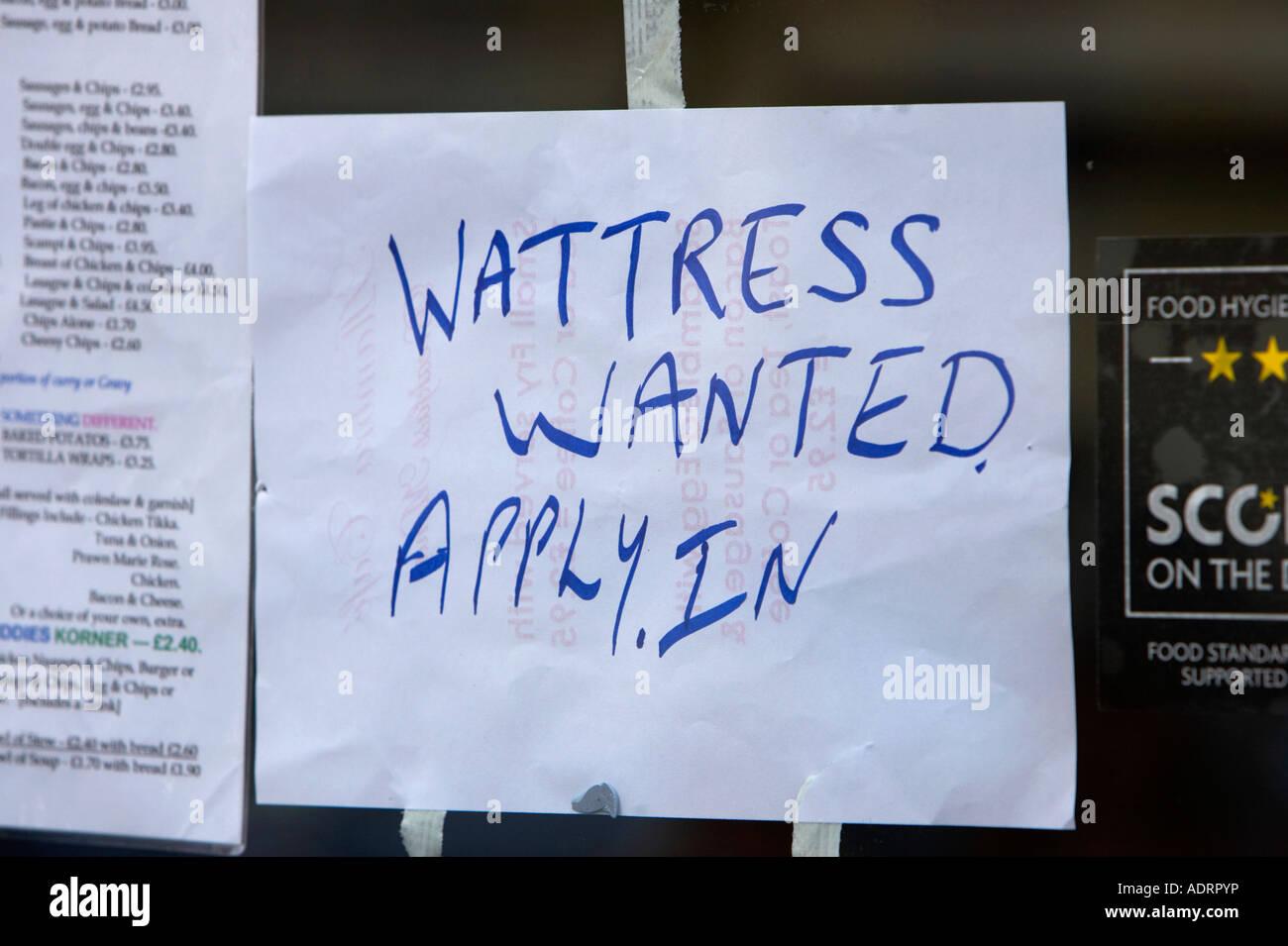 wattress wanted apply in hand written misspelt waitress sign in window of take away cafe in belfast - Stock Image