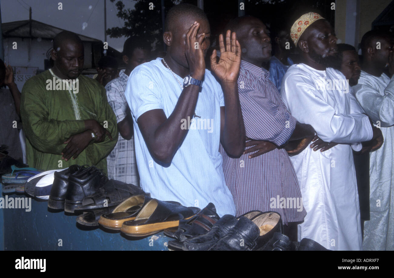 Muslims offering Friday prayers in a mosque in Accra, Ghana - Stock Image
