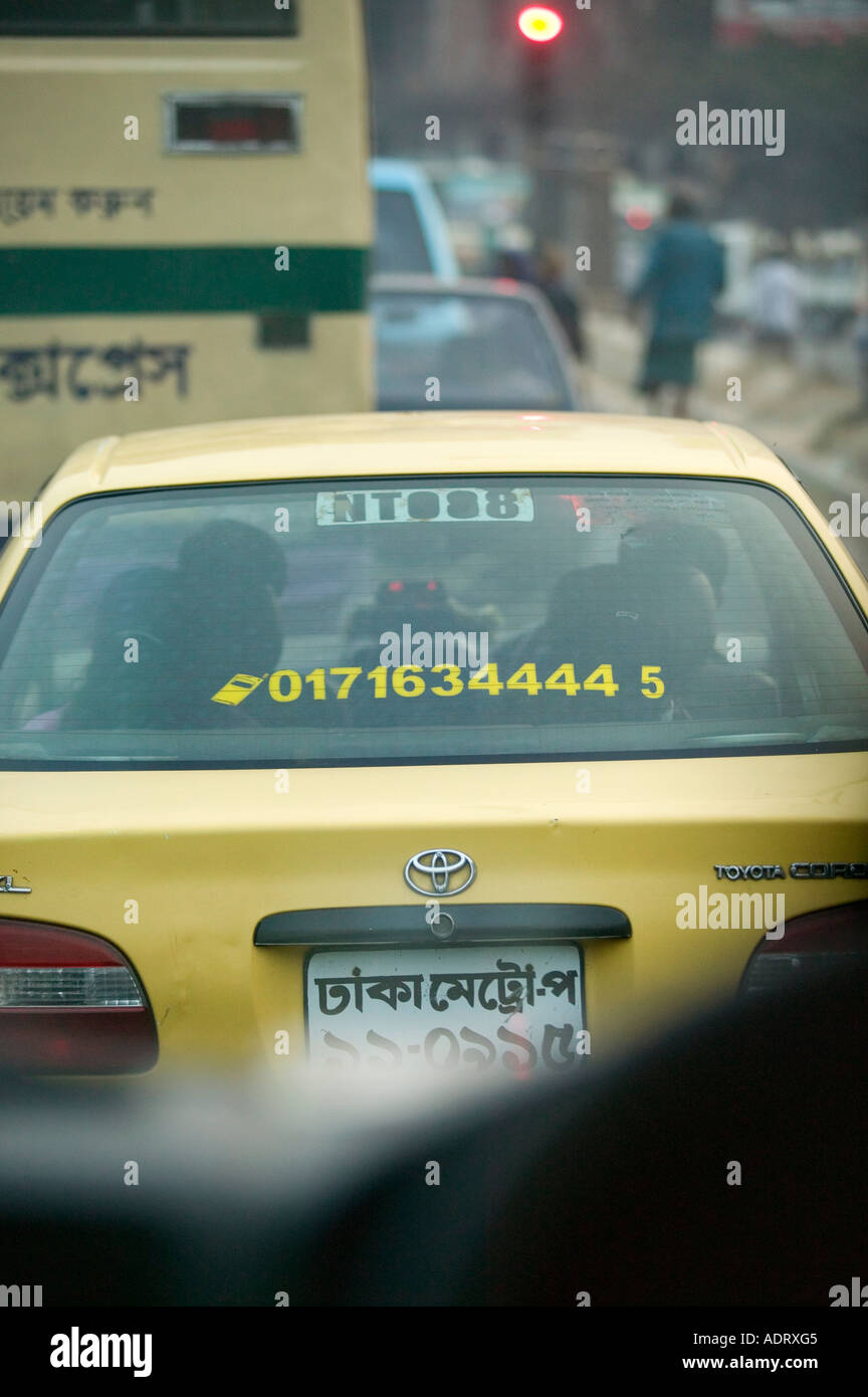 A taxi cab in Dhaka Bangladesh advertising contact mobile phone