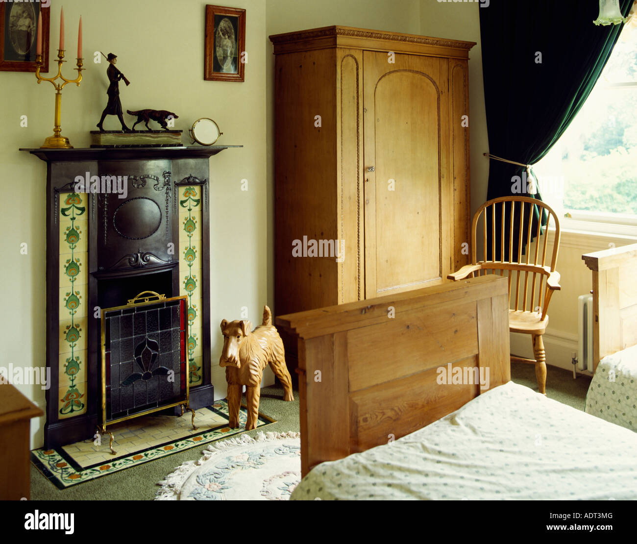Pine Wood Wardrobe And Bed In Bedroom With Small Cast Iron