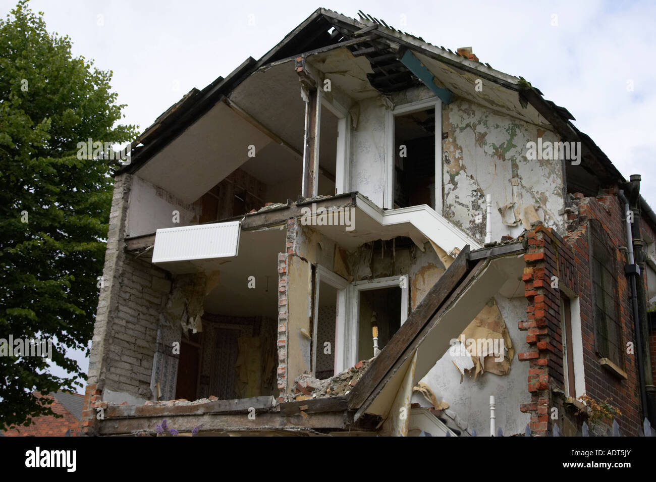 upper floors of partially destroyed old collapsed victorian house in Belfast - Stock Image