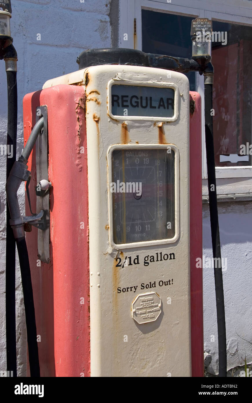 St Mawes one time petrol filling station still retains old petrol pump displaying old shilling penny prices and sold out notice - Stock Image