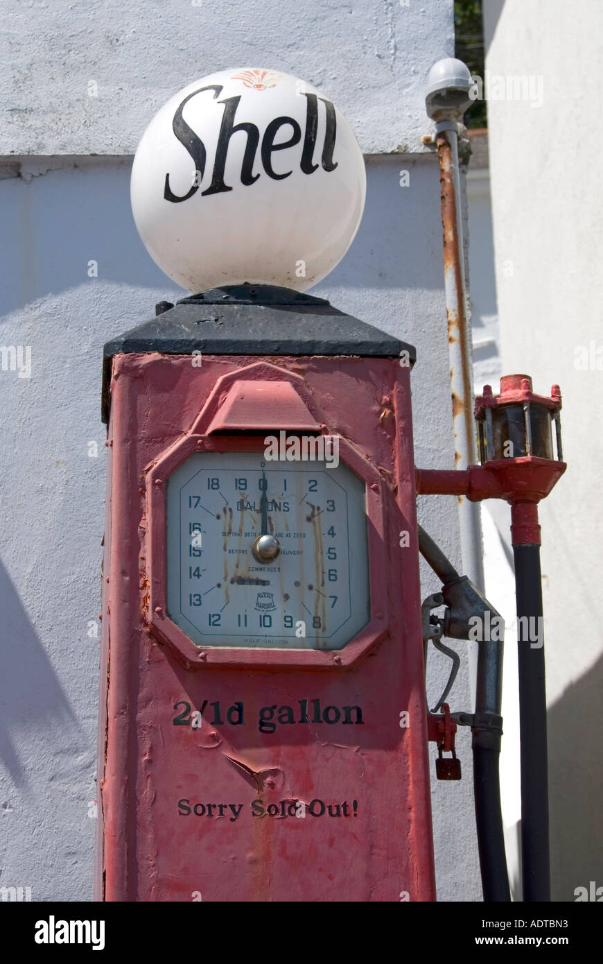 St Mawes one time petrol filling station still retains old Shell petrol pump displaying old shilling penny prices - Stock Image