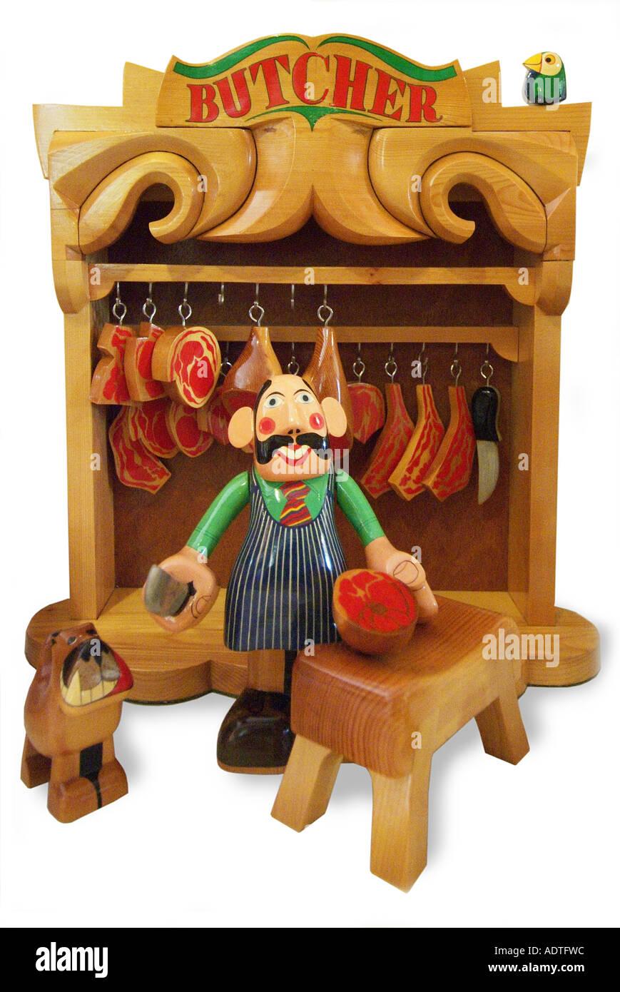 Toy wood wooden Butcher shop meat dog chopper cleaver block side ham beef leg England UK United Kingdom GB - Stock Image