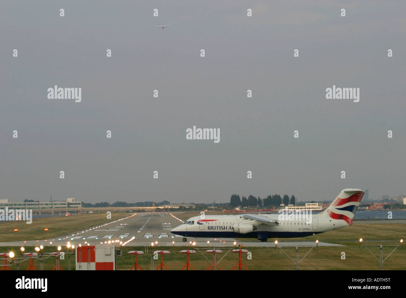 British Airways BAE Systems Avro 146-RJ100 taxiing for departure at London City Airport, England, UK. - Stock Image