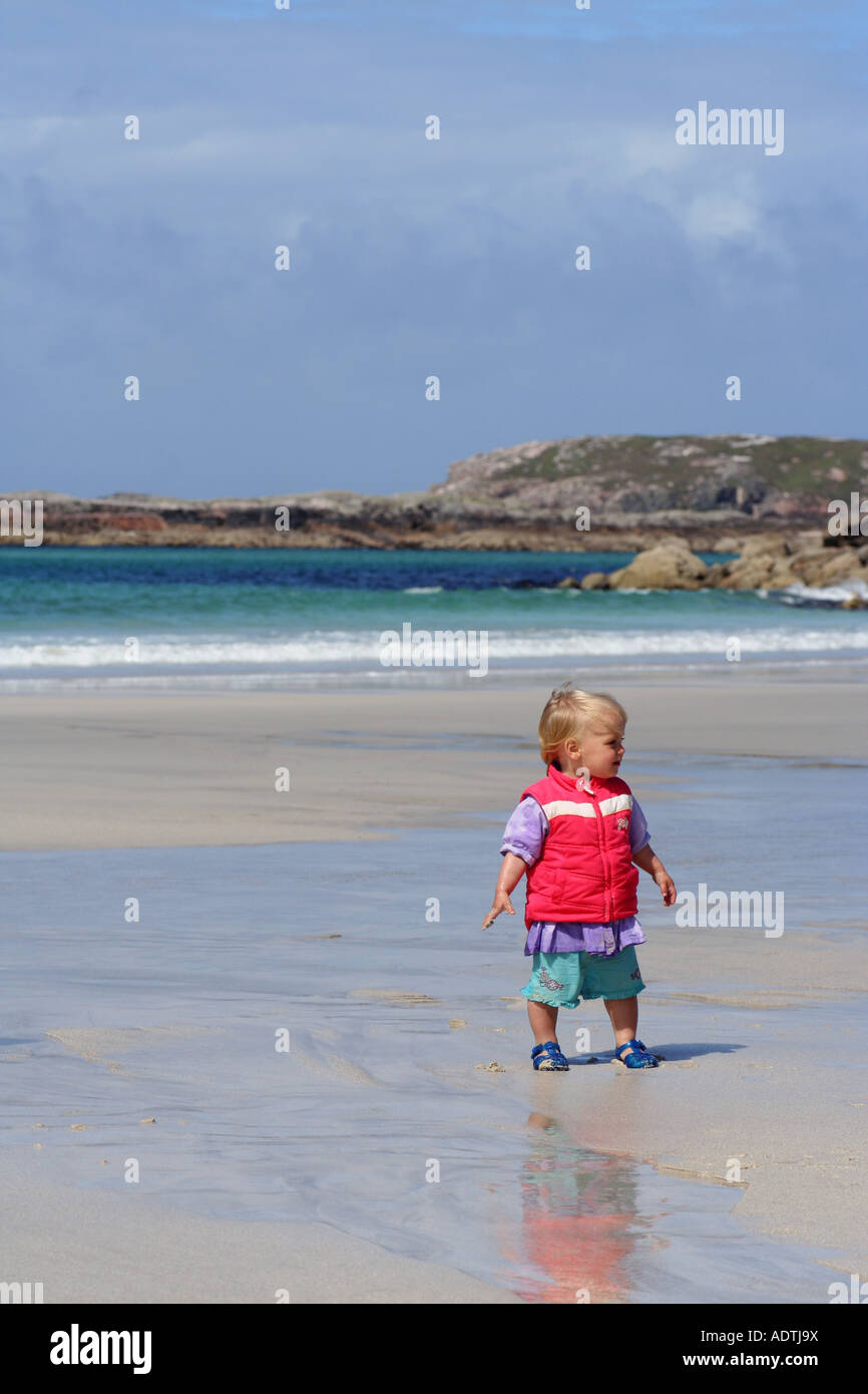 Young girl (18 months old) on Carnish beach Uig Isle of Lewis Scotland UK August 2007 - Stock Image