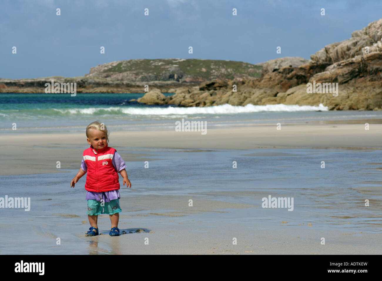 Young girl (18 months old) on Carnish beach, Uig Isle of Lewis Scotland UK August 2007 - Stock Image