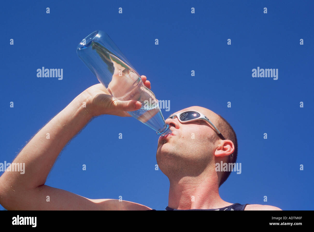 A thirsty athlete / Sportler - Stock Image