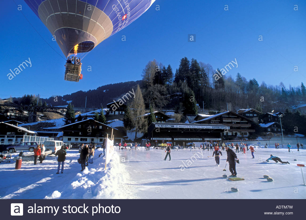 curling rink and hot air balloon in gstaad ski resort, switzerland