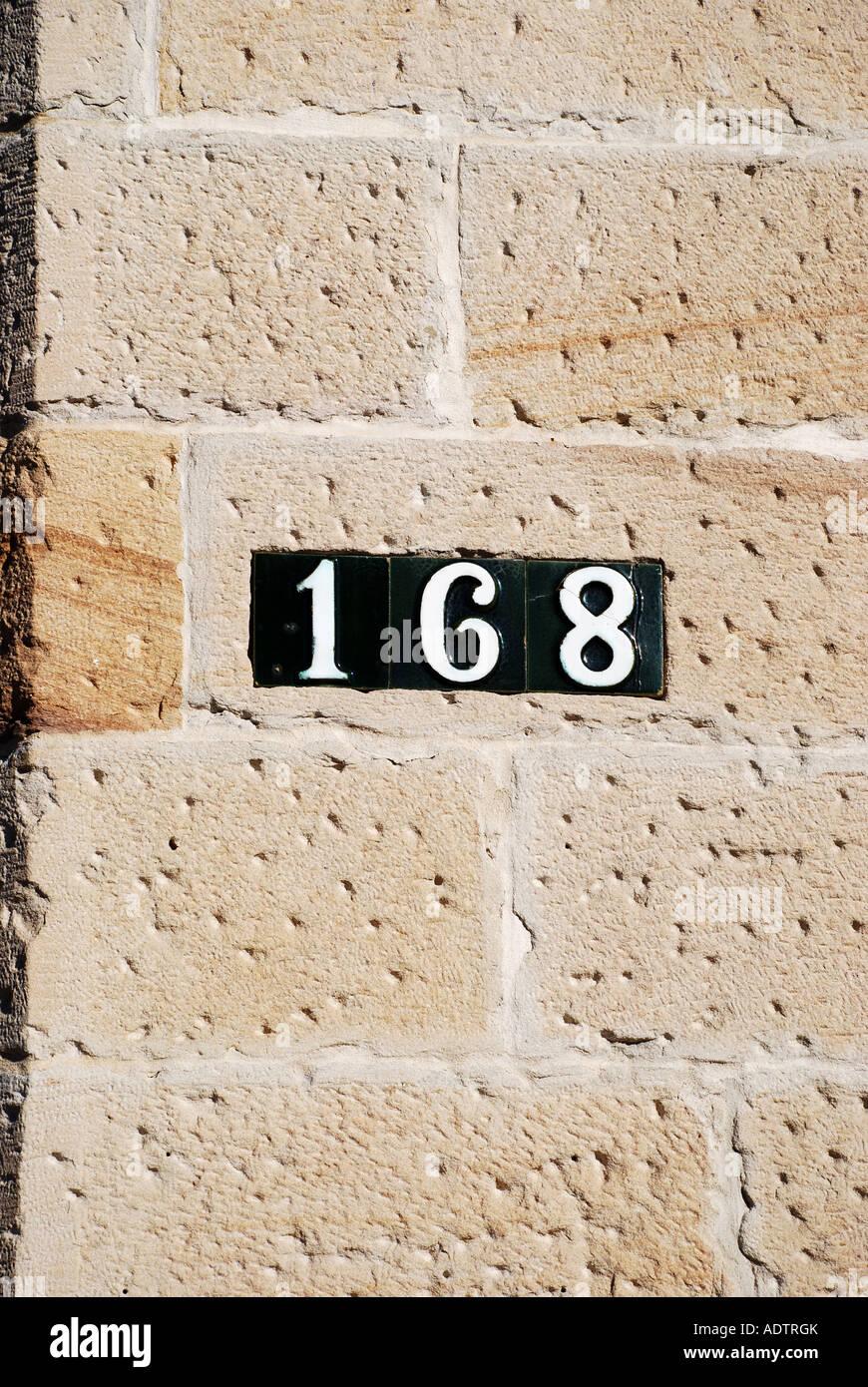 HOUSE NUMBERS ON STONE WALL BALMAIN SYDNEY AUSTRALIA Stock Photo