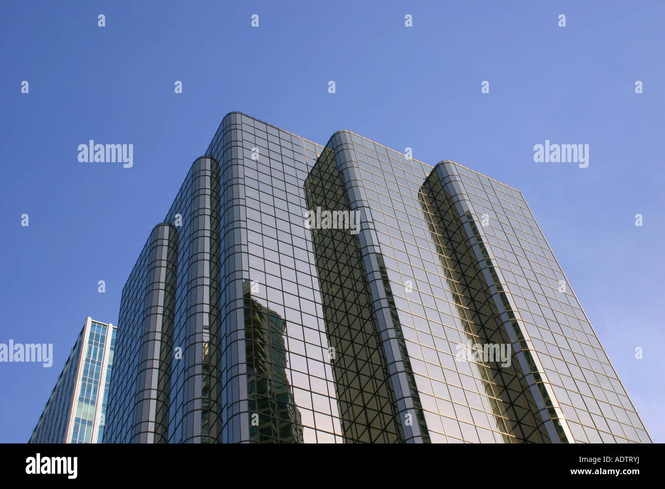Glass high rise building, corner of Hastings St. and Thurlo St, Vancouver, BC. Skyscraper, tower, multistory glass - Stock Image