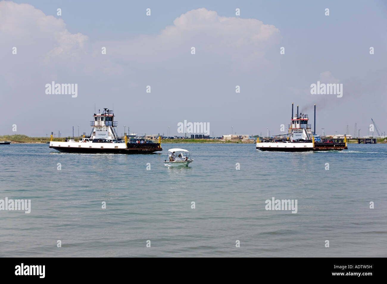 Ferries and a fishing boat Port Aransas TX. Car crossing over bay islands. - Stock Image