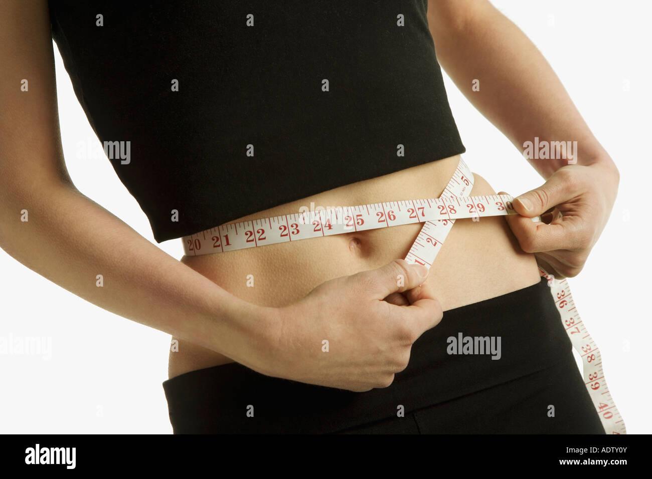 Measuring a waist-line - Stock Image