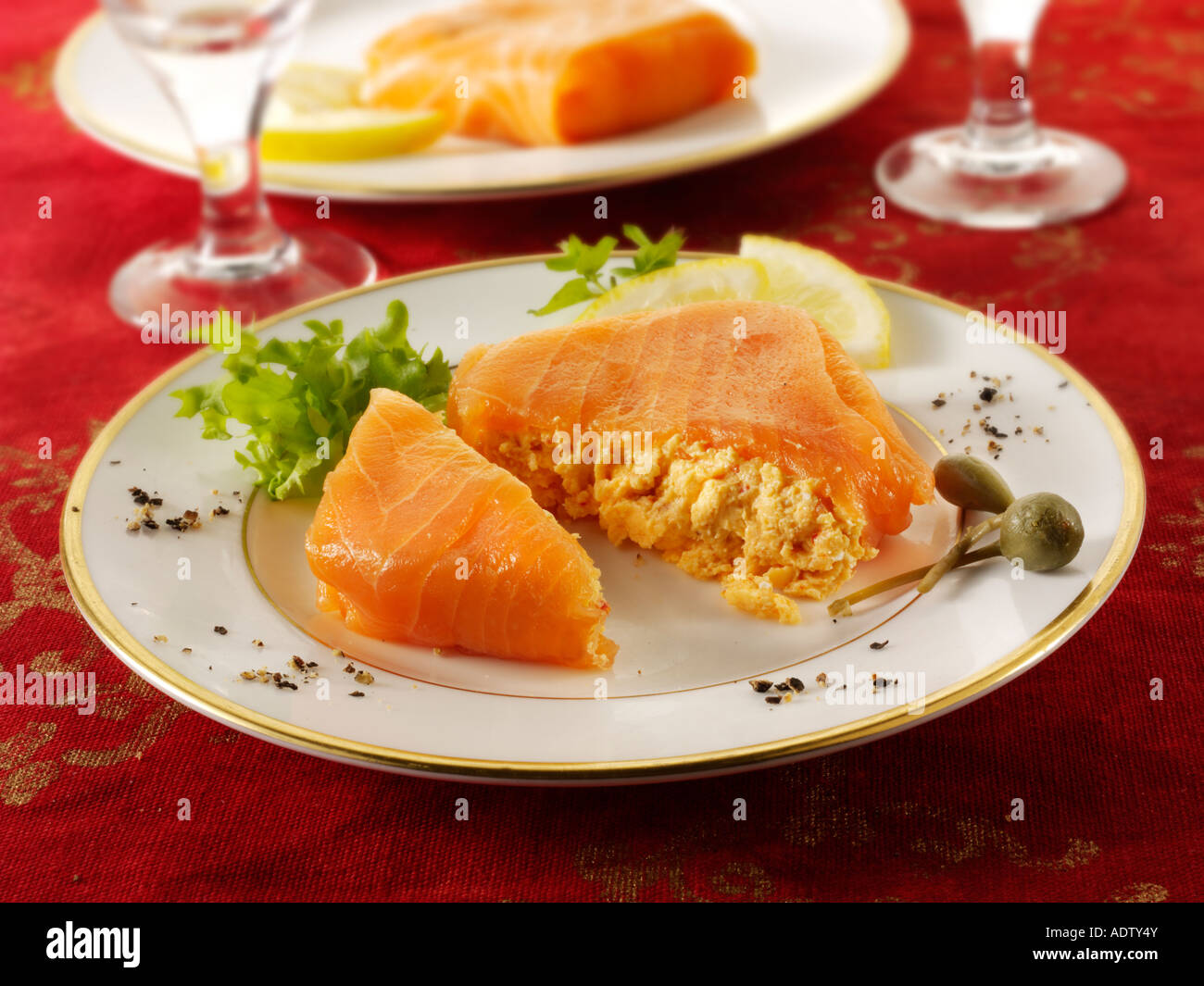 Smoked salmon parcel filled with cream cheese and cream cheese and crab in a party buffet setting - Stock Image
