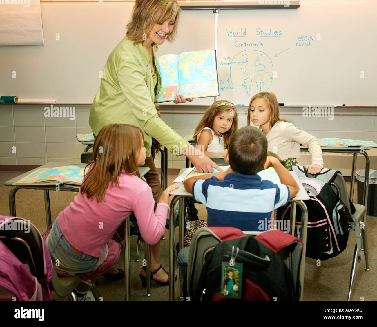 Teacher instructing in a classroom - Stock Image