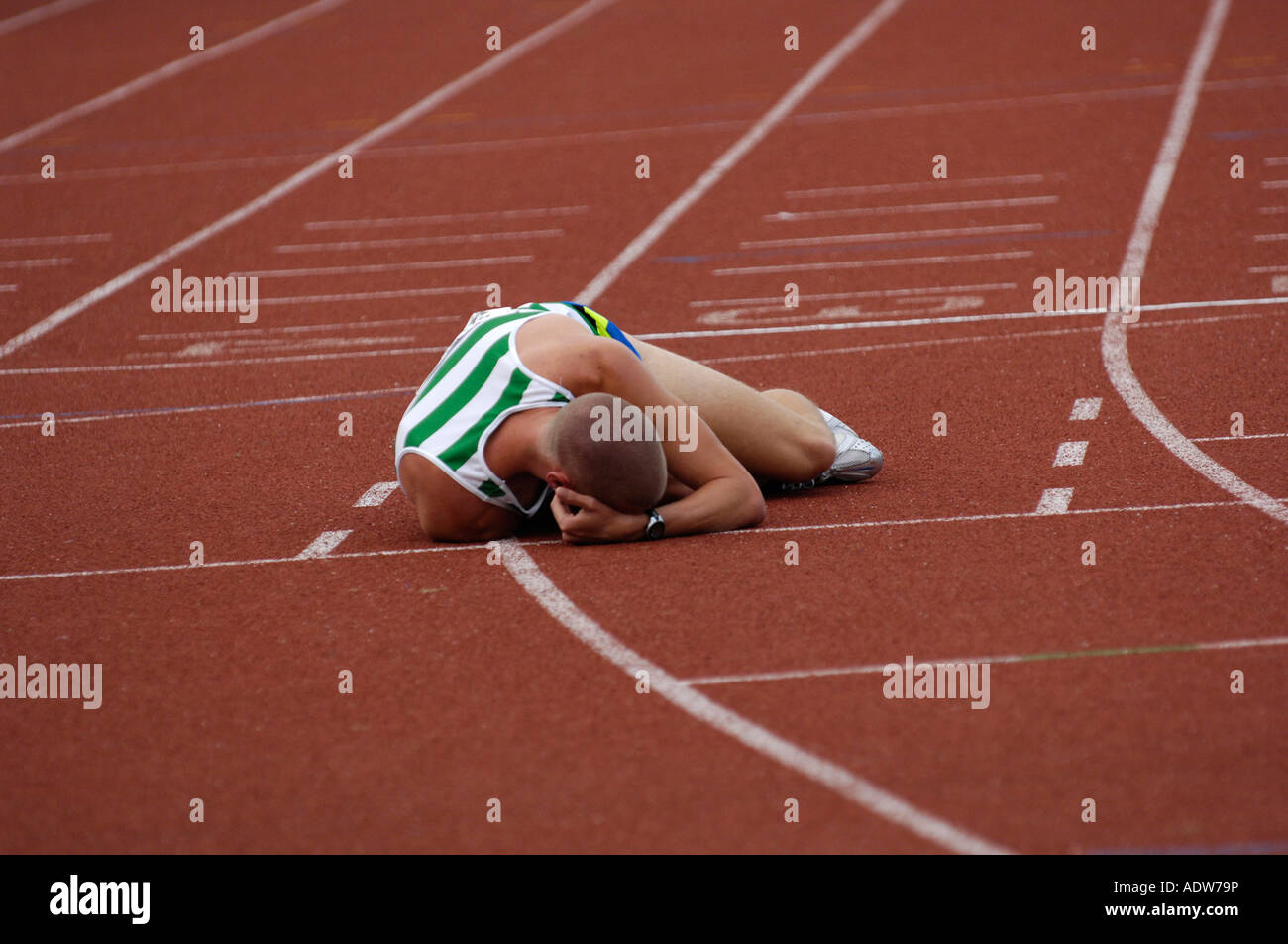 Athlete exhausted after race - Stock Image