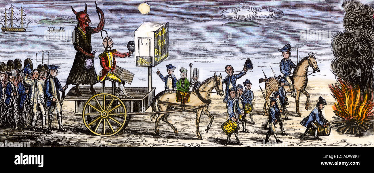 Americans burn Benedict Arnold in effigy after discovery of his treason during the Revolutionary War. Hand-colored woodcut - Stock Image