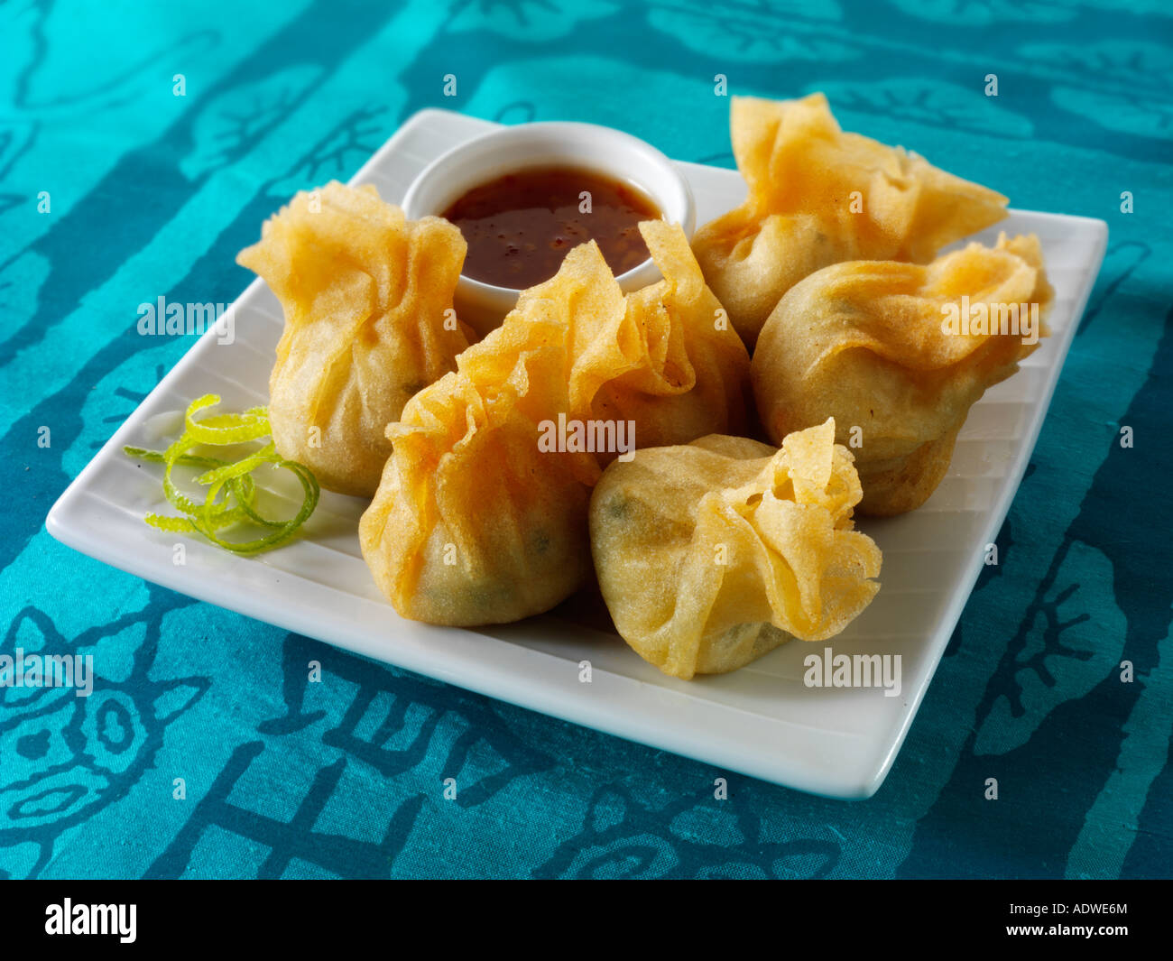 Oriental dim sum with a hoisin dipping sauce - Stock Image