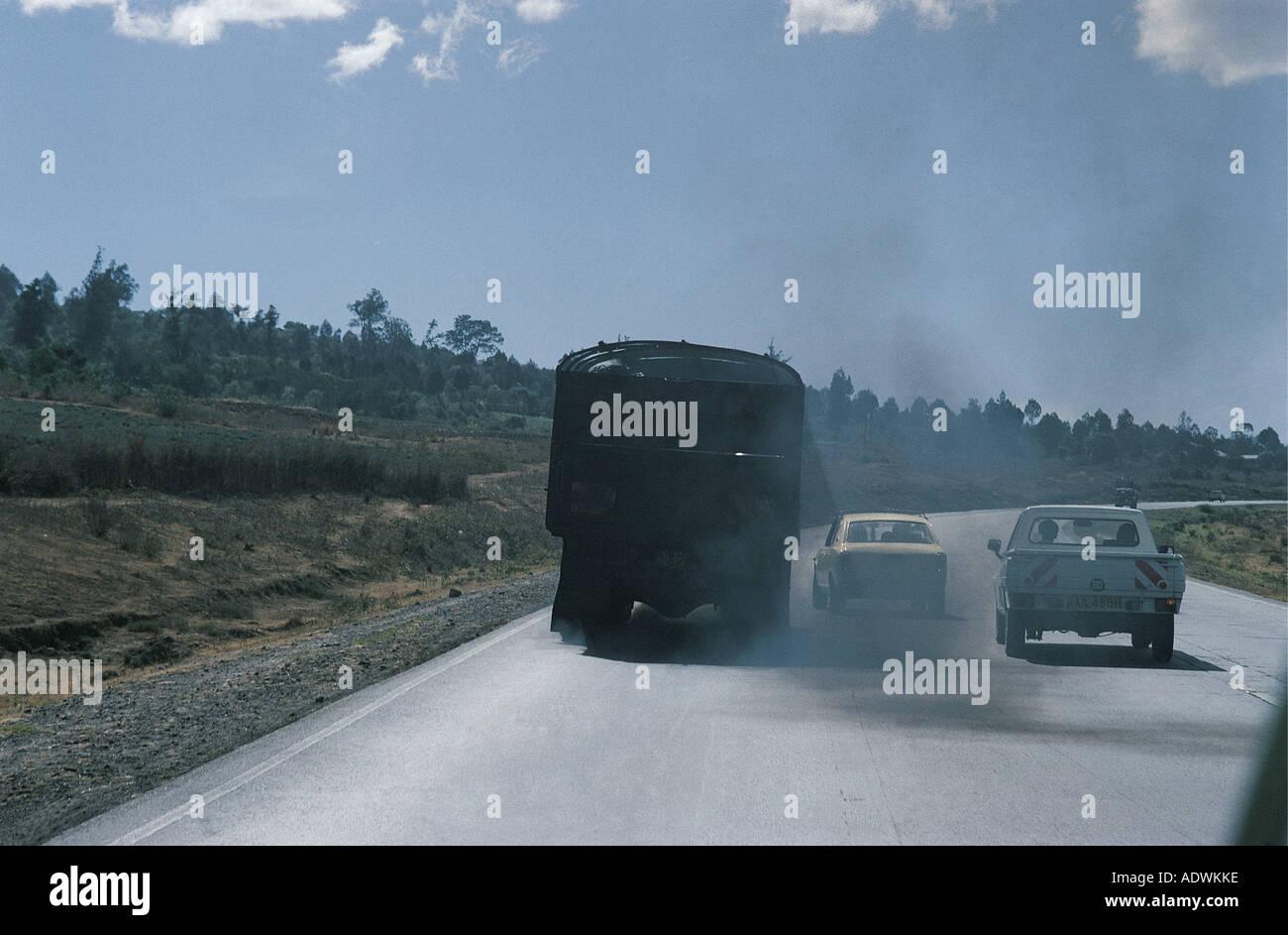 Heavy diesel truck emitting thick black exhaust fumes on the main Nakuru to Nairobi Road Kenya East Africa Stock Photo
