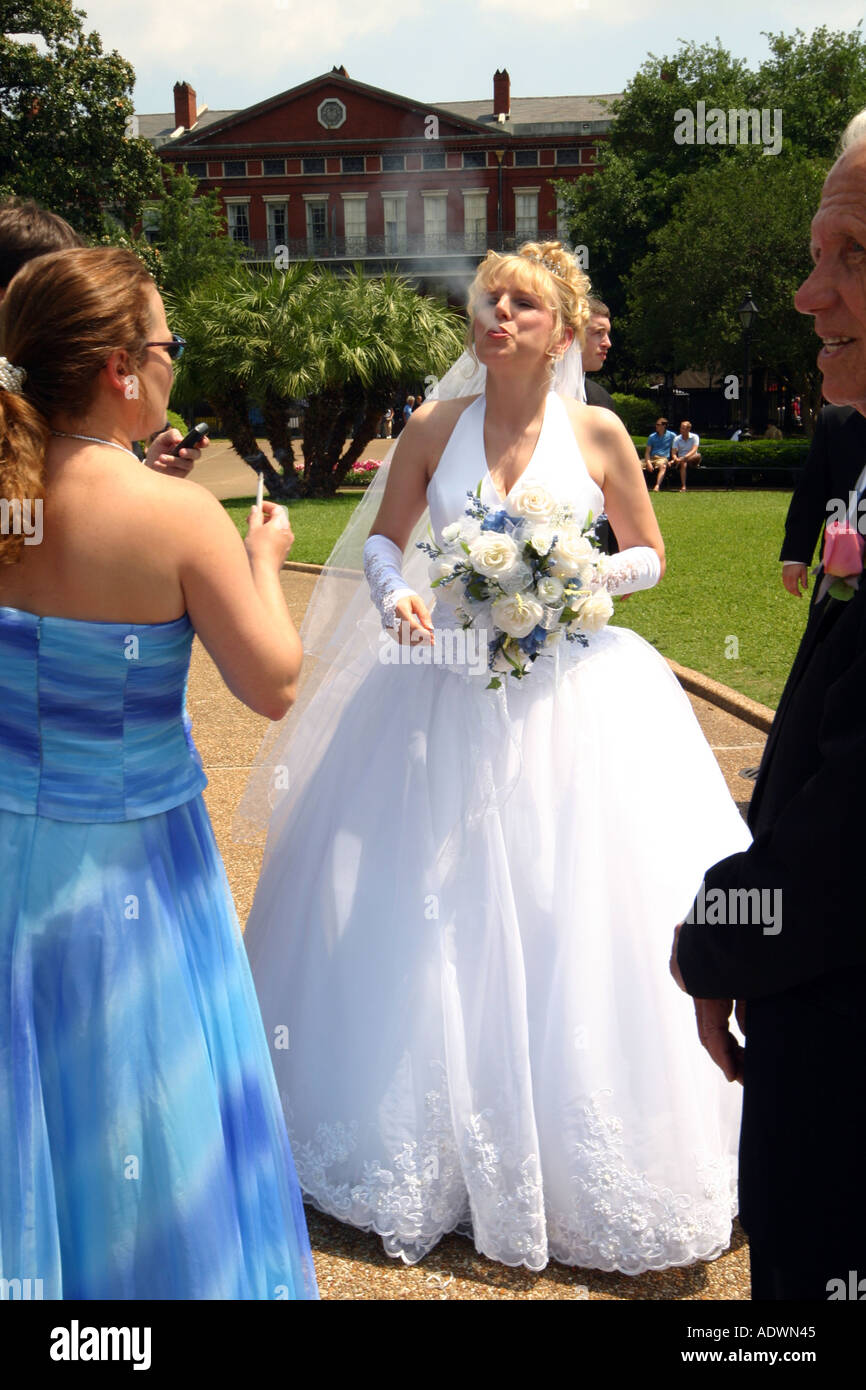 https://c8.alamy.com/comp/ADWN45/nervous-bride-smokes-her-last-cigarette-before-the-wedding-ADWN45.jpg
