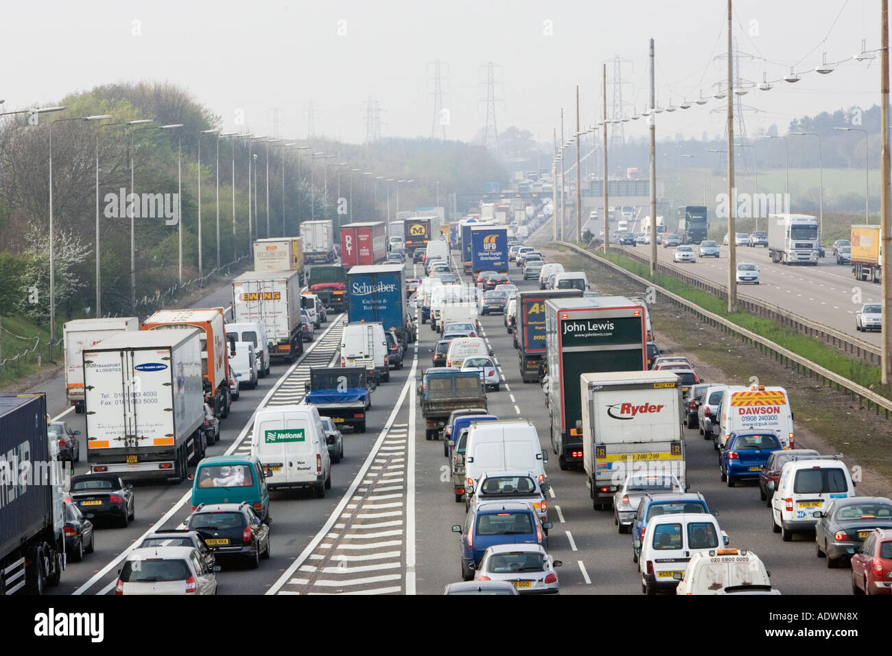 Congested traffic travelling on M1 motorway in Hertfordshire United Kingdom Stock Photo