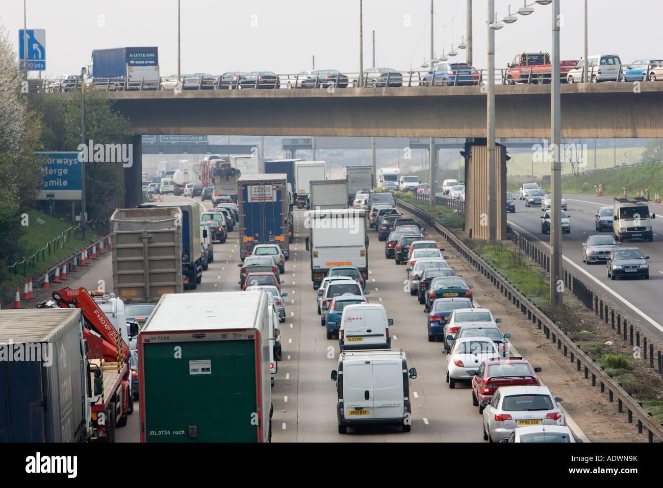 Heavy weight of traffic travelling on M1 motorway in Hertfordshire United Kingdom Stock Photo