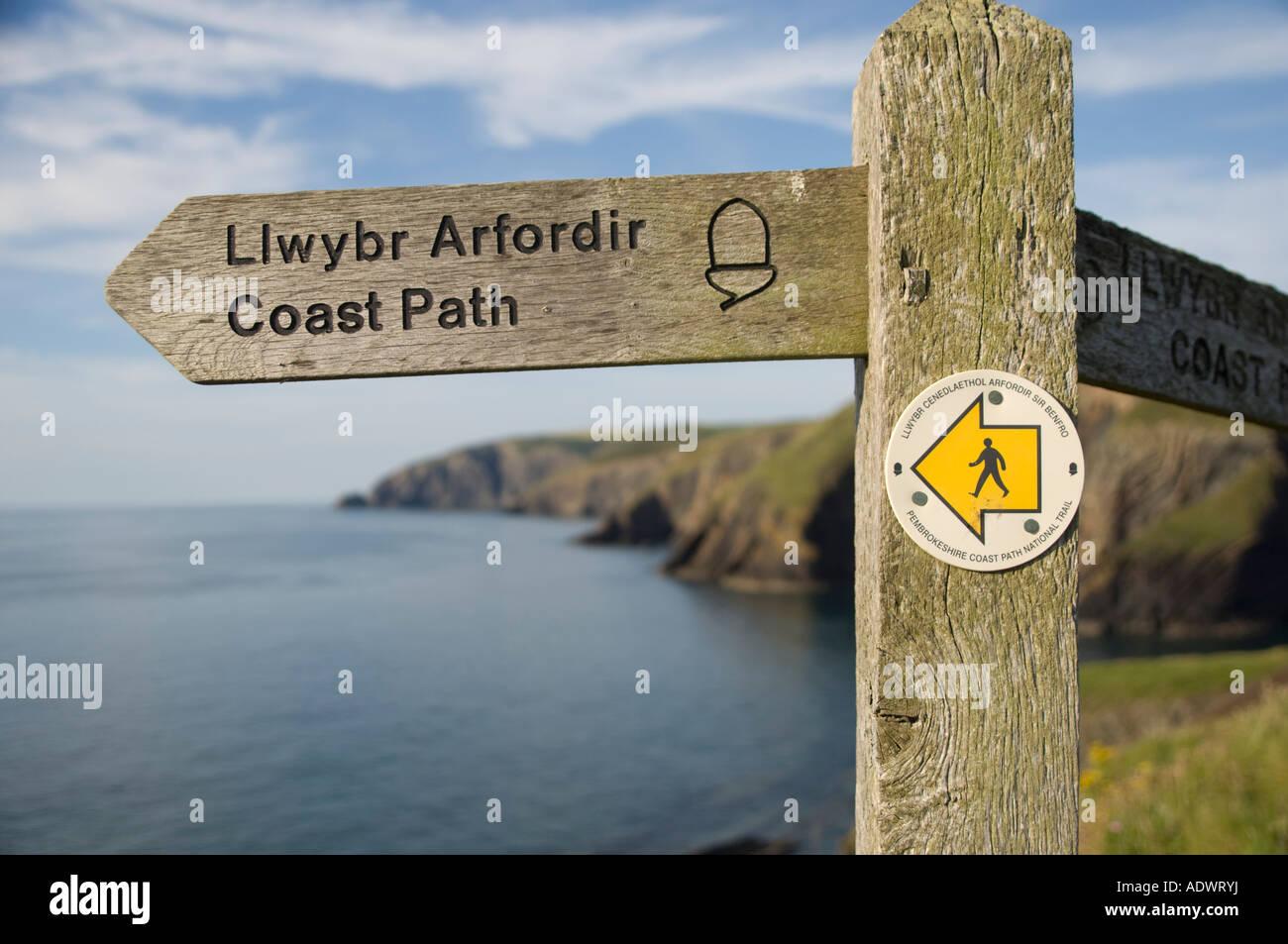 wooden signpost Pembrokeshire coast long distance path Ceibwr Bay west wales cardigan bay coastal walking route - Stock Image