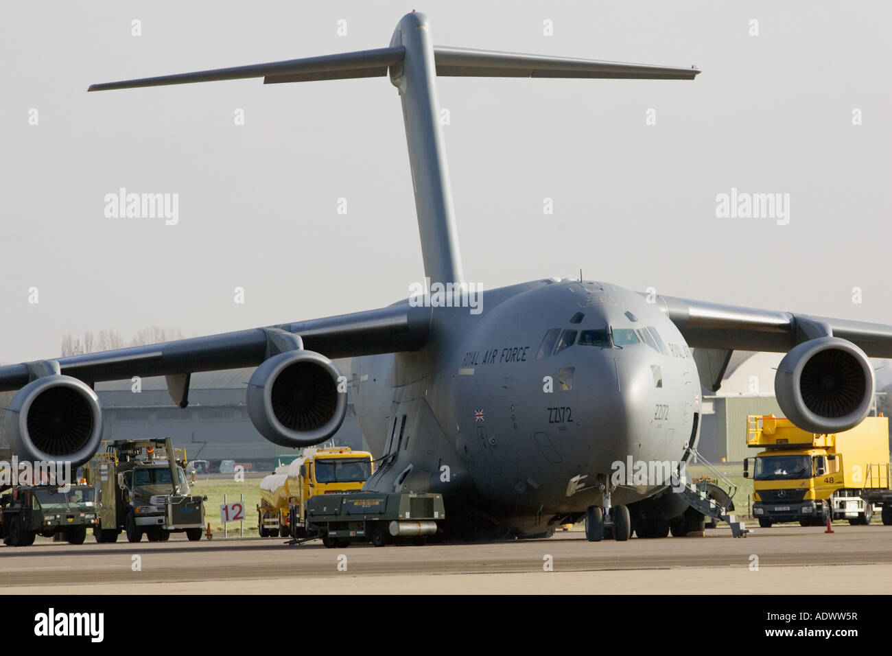 C17 transport plane and ground support at RAF Brize Norton in Oxfordshire United Kingdom - Stock Image